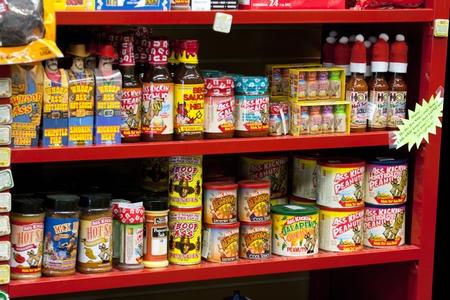 store: Assortment of hot sauce on store shelf Editorial