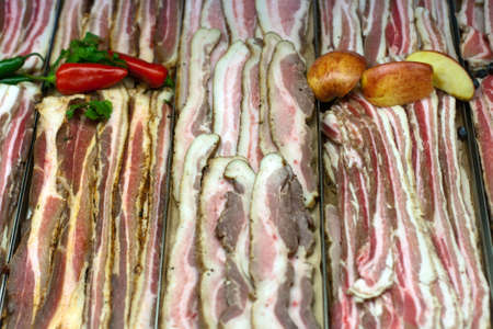 belly pepper: Bacon, pork belly in grocery store display Editorial