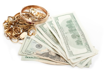 scrap heap: cash dollar for gold and silver scrap Stock Photo