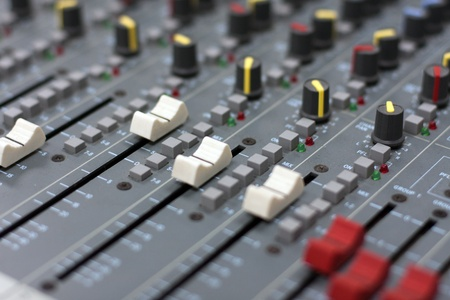 Audio mixer mixing board fader and knobs photo