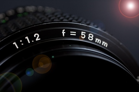 58mm 1.2 lens closeup with flare on black background Stock Photo - 12232050
