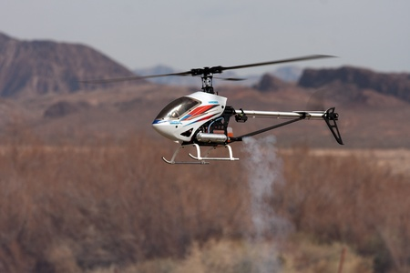 radio active: RC helicopter in flight in front of mountains