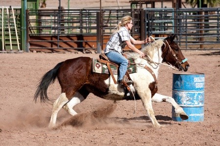 Women horse barrel race in corral in las vegas Editorial