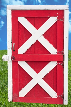 red door: Extractet barn door in red and white with a lock Stock Photo