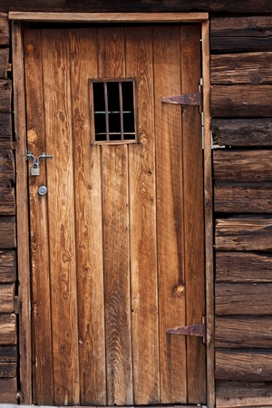 old wild west jail door with small window photo