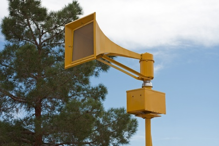 Tornado air raid tsunami siren on pole photo