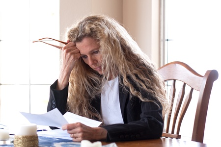 woman worried about bills and debt and foreclosure photo