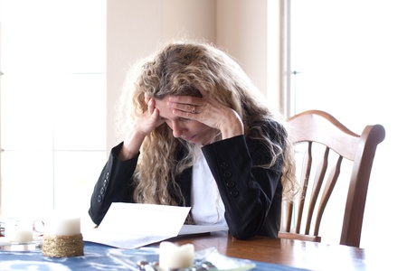 woman worried about bills and debt and foreclosure