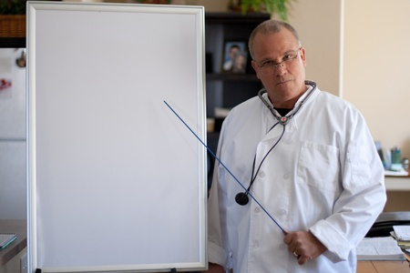 doctor wich clipboard empty copy space and pointing device Stock Photo - 13222564