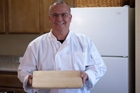 Chef with empty cutting board and space for food design Stock Photo - 13222562