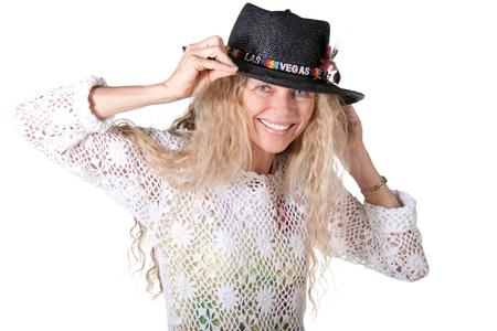 mujer hippie: mujer madura con hippie de Las Vegas sombrero sonriendo