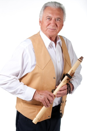 senior musician with native american flute and leather vest Stock Photo