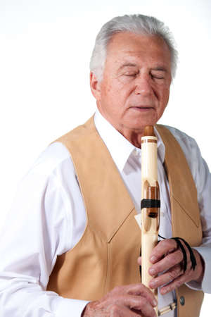 senior musician with native american flute and leather vest Stock Photo - 14410135