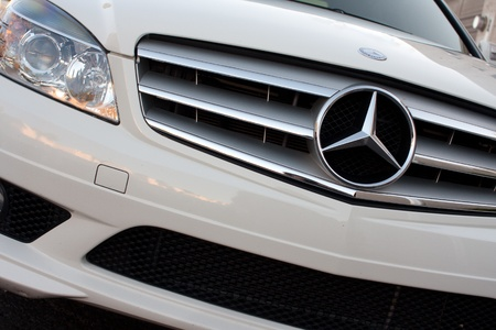 white Mercedes car front grill and star