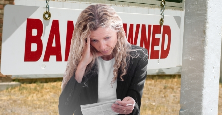 bank owned: frustrated woman over foreclosure mortgage payment Stock Photo