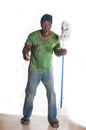 old beggar: African American homeless man cleaning with mop Stock Photo