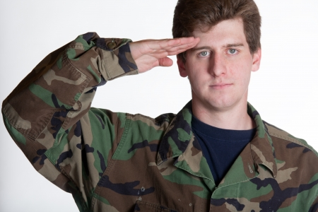 Young soldier saluting in camera