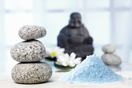 Bhuddha, hot stones, bath salts and water lilies