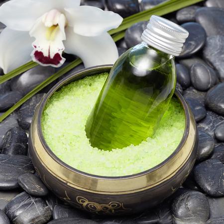 singing bowl massage: Bath salts, bath oil and chrysanthemum Stock Photo