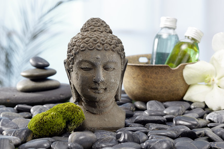 thalasso: Buddha with bath oil and hot stones Stock Photo