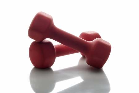 exempted: Red Dumbbells on a white background Stock Photo
