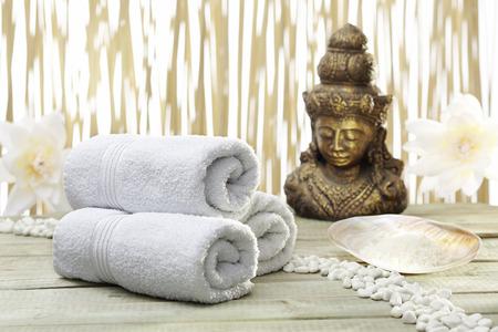 thalasso: Bath accessories with golden buddha statue Stock Photo