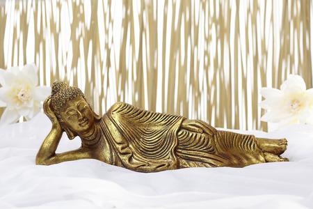 Bath accessories with golden sleeping buddha Standard-Bild