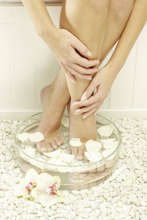 woman spa pedicure foot treatment photo