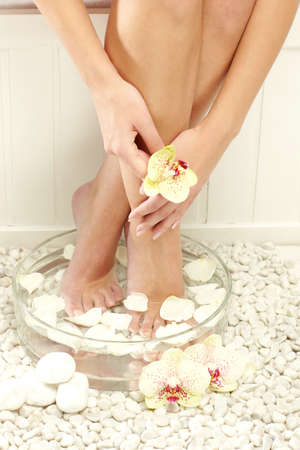 woman spa pedicure foot treatment photo
