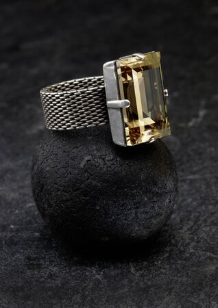 silver ring: Silver ring with yellow gemstone Stock Photo