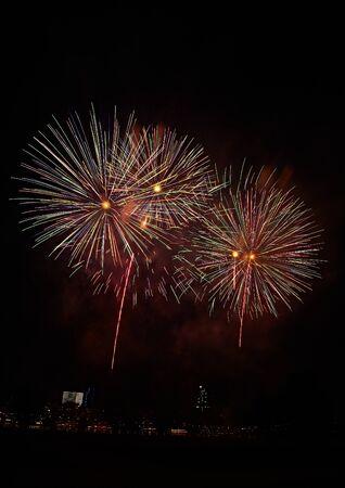 Fireworks, firecrackers, rockets across night sky