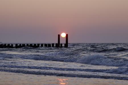 Sunset at the beach Standard-Bild