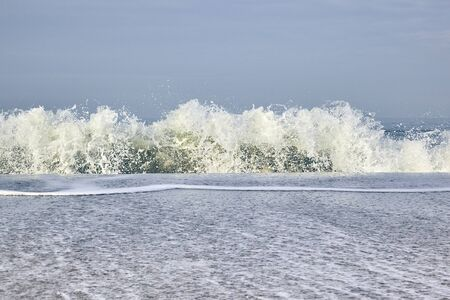 Waves wash round the North Sea Beach