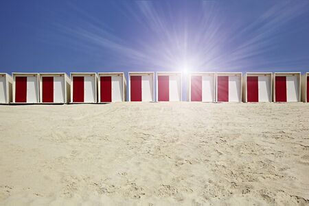 Cabins on the beach in the sand in sunny weather Standard-Bild