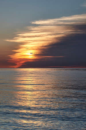 Sunset with clouds on the North Sea in Holland