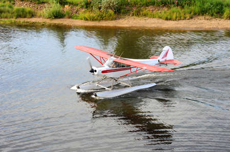 Alaskan water plane is getting ready to take off the Chena River .