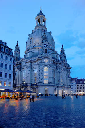 The Frauenkirche square in Dresden Germany at the magical blue our or twilight hour, as the lights go on and the evening events come to life.