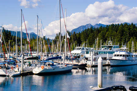 Boat marina in the Vancouver, Canada area full of sailboats and other motor operated boats.