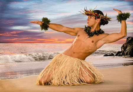 A sunset hula on the beach with a male hula dancer in traditional costume.