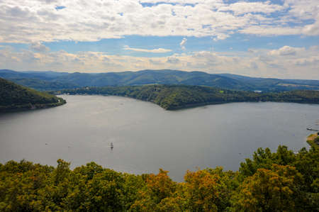 The Edersee reservoir is a sailboat paradise in Germany that has beautiful lakefront landscapes and pristine views.
