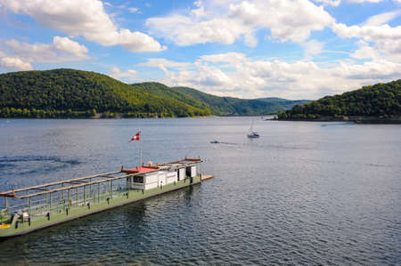 A beautiful day on the lake with boats on the Edersee fed by the Eder river in northern Hesse, Germany.