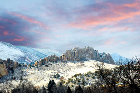A stunning landscape view of the Garden of the Gods, Colorado, after a winter dusting on the stark sandstone cliffs.