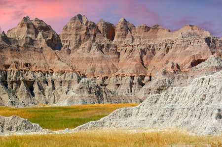 Badlands National Park in South Dakota right before sunset as the sky start to change colors and so do the rock formations.