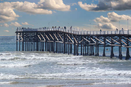 Crystal Pier in San Diego with puffy white clouds on an otherwise blue sky day.