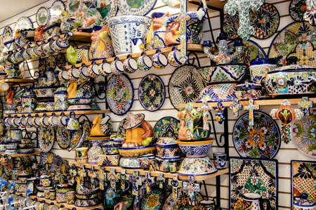 Wall of art objects, knick knacks, and tourist items for sale in Cancun, Mexico.