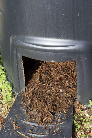Closeup of Compost bin to recycle garden and kitchen waste Standard-Bild