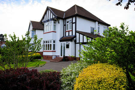Typical 1930s white semi detatched house with Bay Window and pretty garden, in Bristol, England