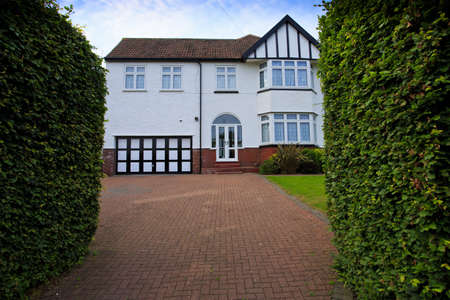 Typical 1930s white semi detatched house with Bay Window and large driveway, in Bristol, England