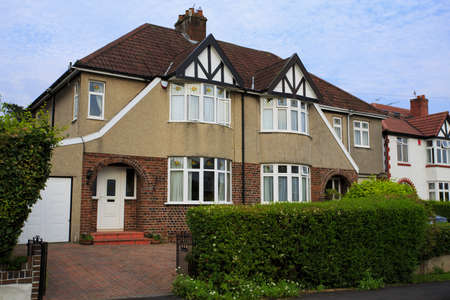 Typical 1930s pebble dashed semi detatched house with Bay Window, in Bristol, England Editorial