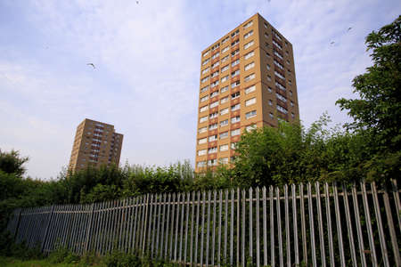 council: Two council tower blocks with Fence in Bristol UK